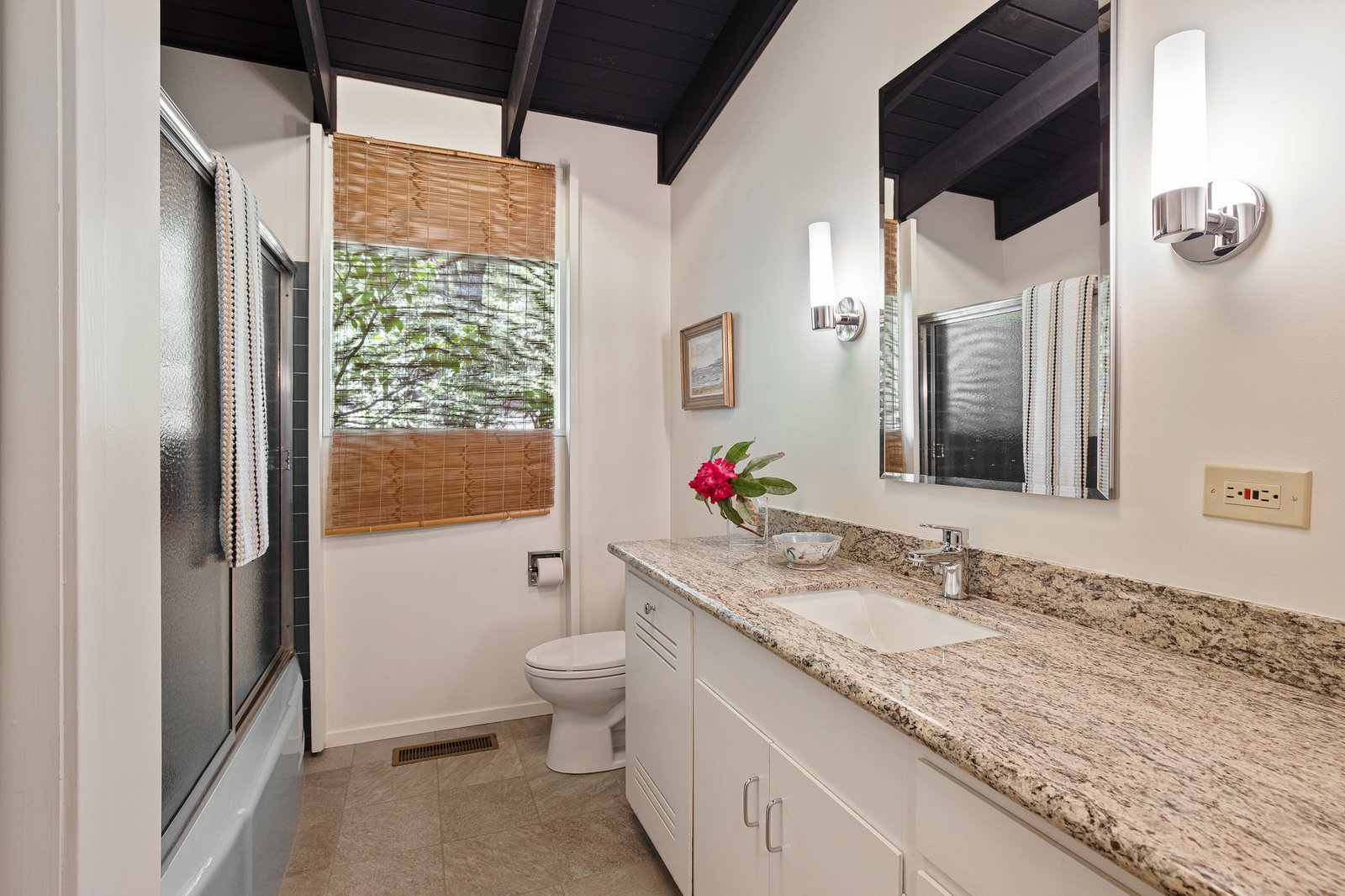 All of the bathrooms have been modernized with new finishes.  Photo 13 of 21 in An Impeccable Midcentury Compound in the Berkeley Hills Wants $3.4M