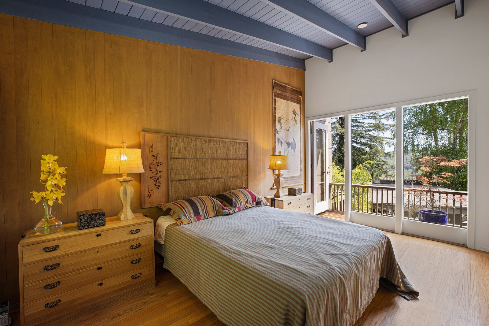A blue-painted ceiling adds a touch of color in the master suite, which also offers a private outdoor space.  Photo 12 of 21 in An Impeccable Midcentury Compound in the Berkeley Hills Wants $3.4M
