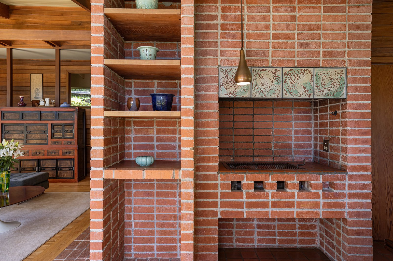 A closer look at the original wood-fired pizza oven and adjacent built-ins.  Photo 7 of 21 in An Impeccable Midcentury Compound in the Berkeley Hills Wants $3.4M