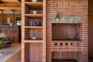 A closer look at the original wood-fired pizza oven and adjacent built-ins.