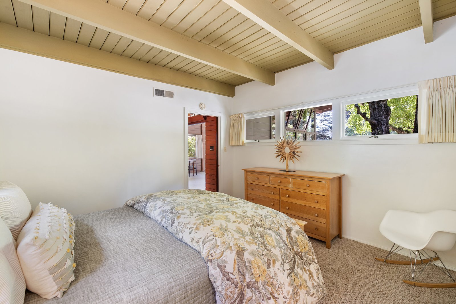 A peek at the single bedroom in the guest house.  Photo 19 of 21 in An Impeccable Midcentury Compound in the Berkeley Hills Wants $3.4M