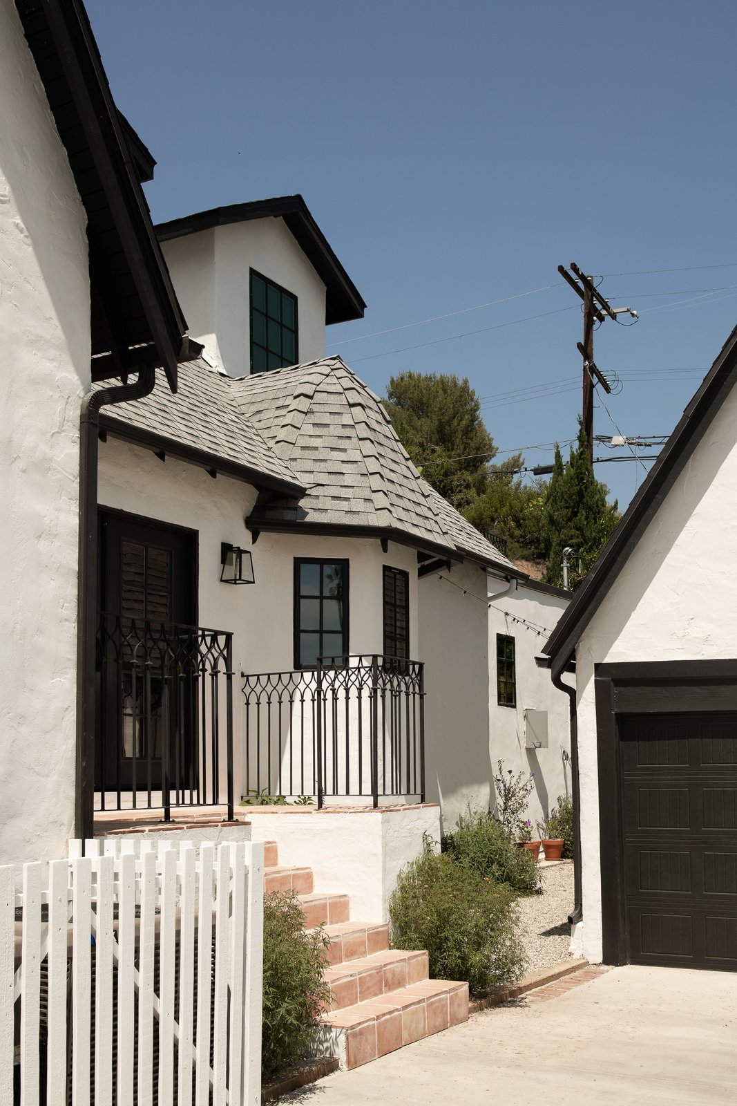 Exterior of Tudor Renovation by VEIN Design and Bungalowe