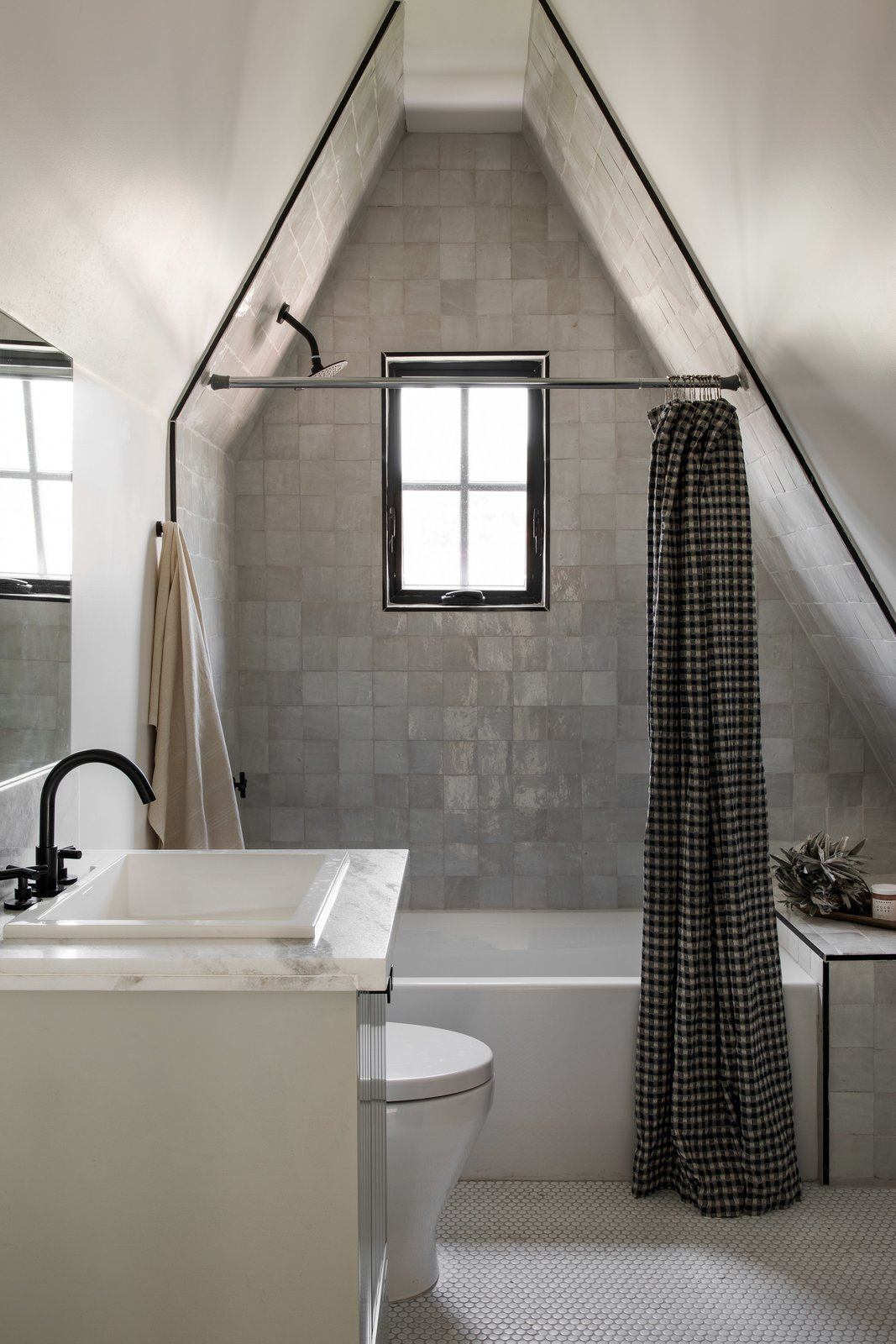 Bathroom in Tudor Renovation by VEIN Design and Bungalowe