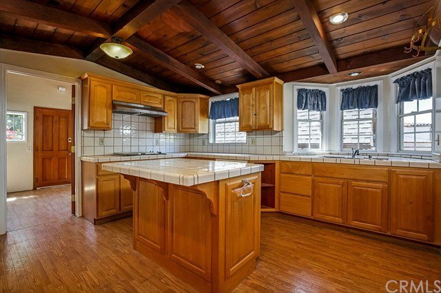 Before: Kitchen of Tudor Renovation by VEIN Design and Bungalowe