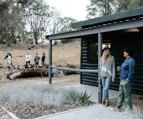 A look at one of the property's two log cabins. The charred exterior contrasts with a lighter, wood-clad interior.