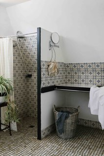 A look at the bathroom, which features antique tile and fixtures.