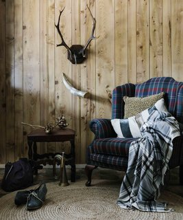A look inside one of the log cabins. Antiques the couple brought in from Sydney and locally found pieces fill the space.