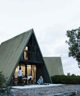 In Esperance, Australia, Fiona and Matt Shillington turned an outdated holiday resort into a cozy compound with restored A-frames, log cabins, and cottages.