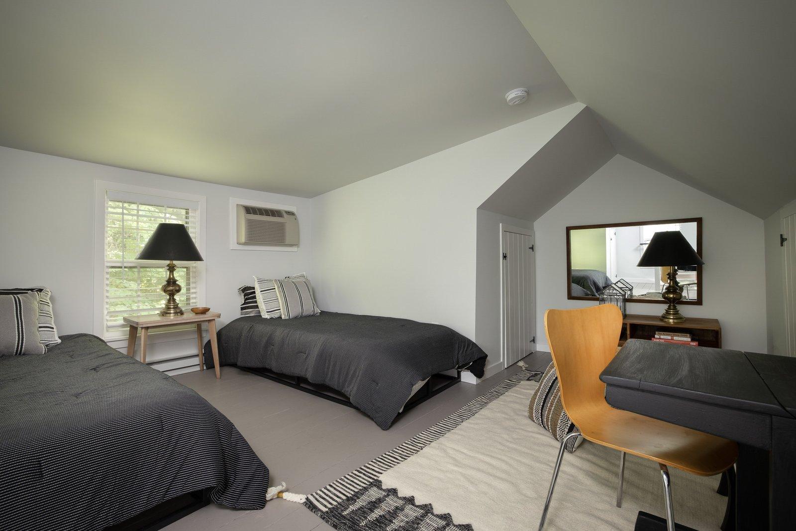 New England–style cottage loft bedroom