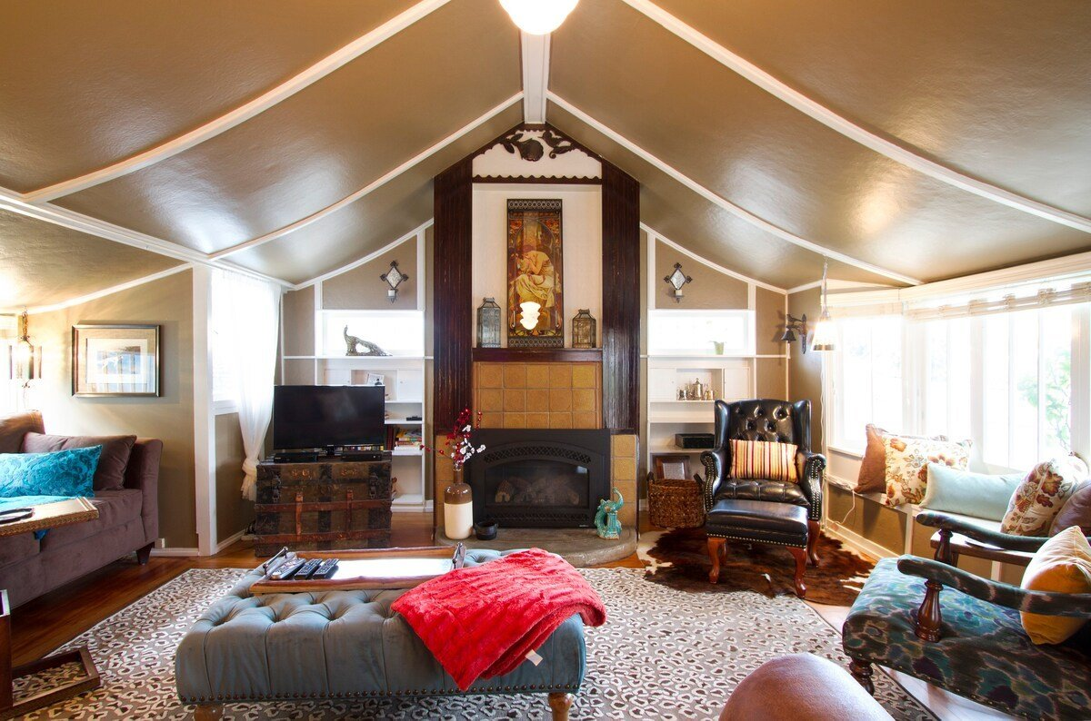 A pitched ceiling in the living area is one of many original details in the Steinbeck Cottage. The 900-square-foot abode is surrounded by a private garden with an outdoor area for guest use.  Photo 13 of 13 in 6 Famous Writer's Retreats You Can Rent When You're Ready to Write That Novel