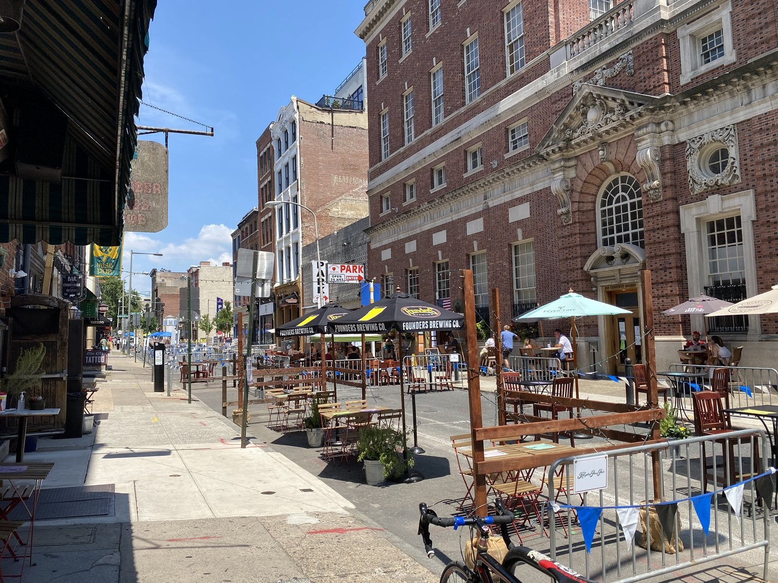 In Old City, Philadelphia, a street closed to vehicle traffic allows pedestrians to use the full length of the sidewalk and restaurant patrons to dine outdoors.  Photo 6 of 9 in In Times of Crisis, Hostile Architecture Poses a Bigger Threat Than Ever