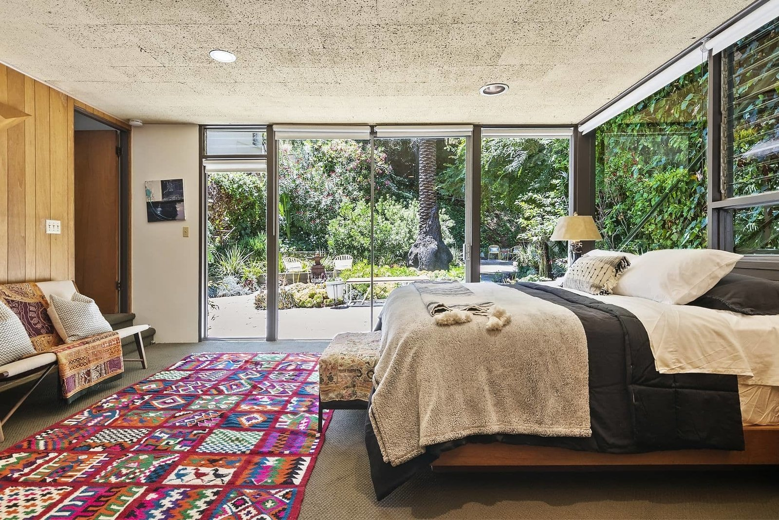 The lower-level master suite features sliding glass doors that open to the garden.  Photo 11 of 15 in A John Lautner Post-and-Beam Hits the Market for the First Time Ever