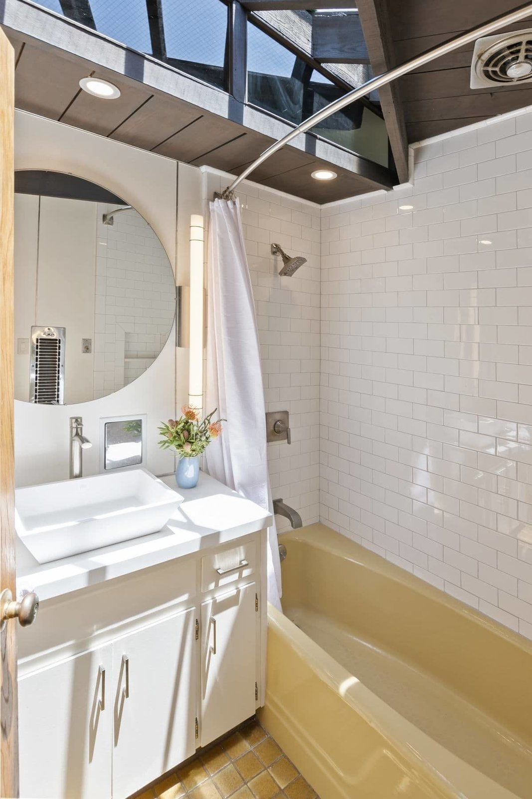 The upstairs bathroom is illuminated by an original skylight.  Photo 10 of 15 in A John Lautner Post-and-Beam Hits the Market for the First Time Ever
