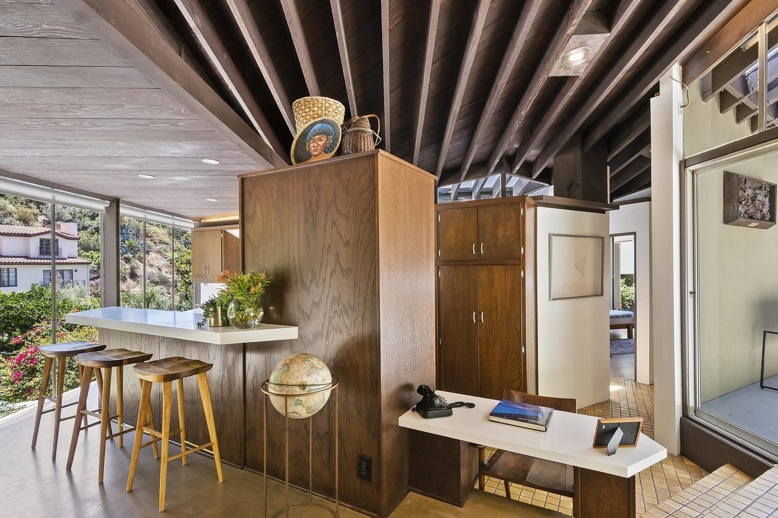 The galley-style kitchen is defined by a wall of cabinetry and  Photo 6 of 15 in A John Lautner Post-and-Beam Hits the Market for the First Time Ever