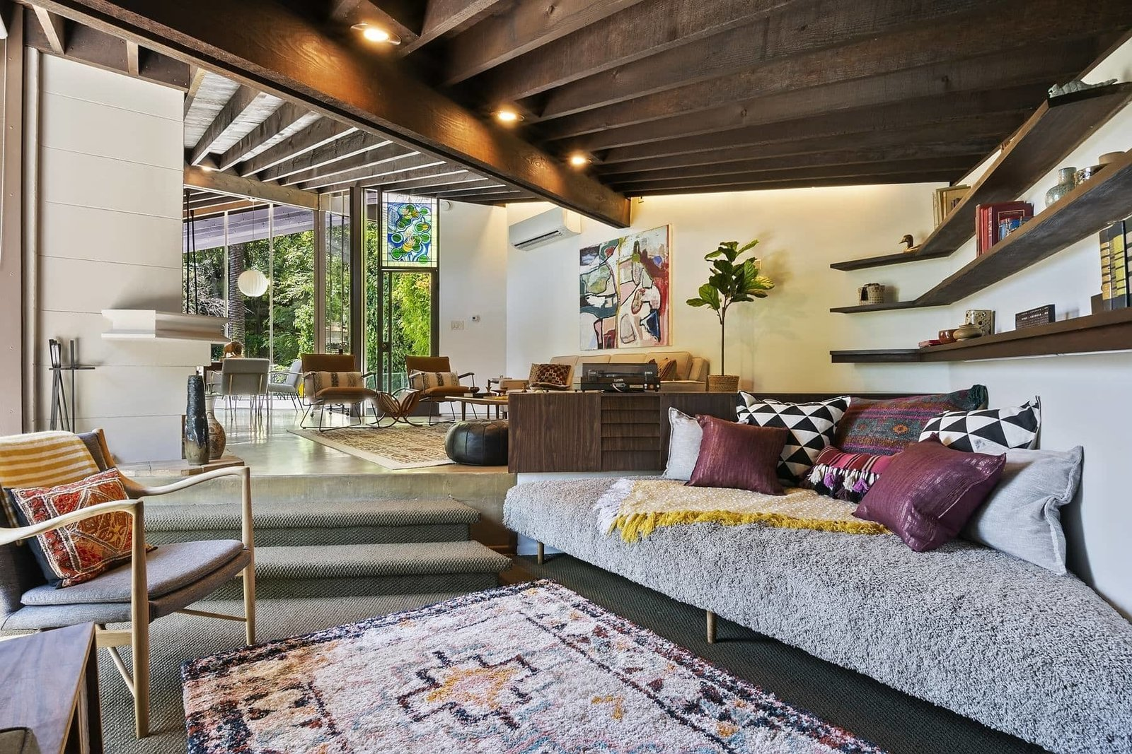 A sunken seating area in one corner of the living room features a built-in bench and shelving.  Photo 3 of 15 in A John Lautner Post-and-Beam Hits the Market for the First Time Ever