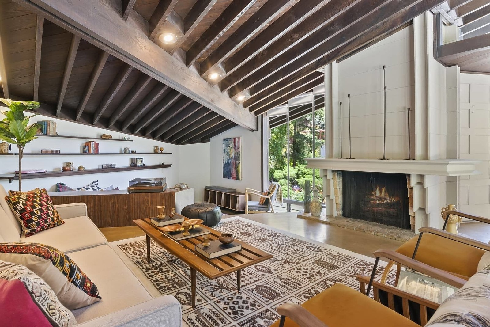 Inside, the home's original features are offered in pristine condition after a 2018 restoration lead by Helena Arahuete, who took over Lautner's firm after his death. The living area features an inter-locking concrete block fireplace—a one-of-a-kind Lautner design feature.  Photo 2 of 15 in A John Lautner Post-and-Beam Hits the Market for the First Time Ever