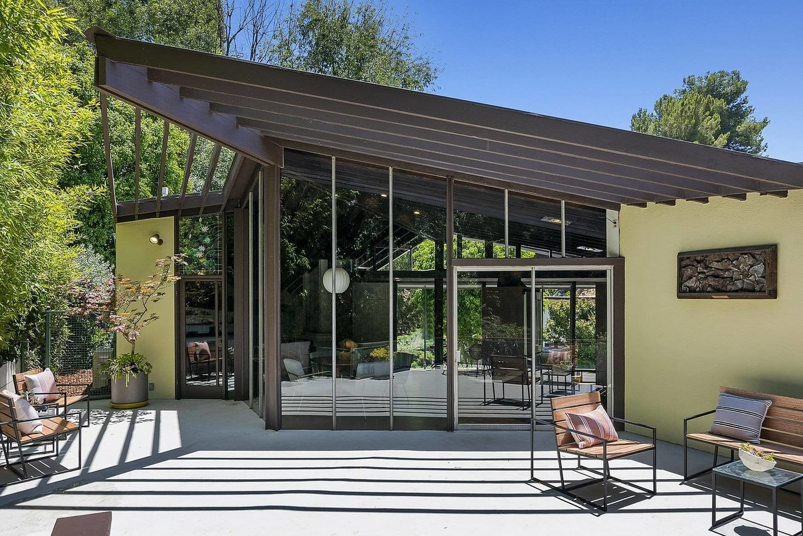 The roofline culminates at one corner of the home, creating an overhang around the dining area.  Photo 12 of 15 in A John Lautner Post-and-Beam Hits the Market for the First Time Ever