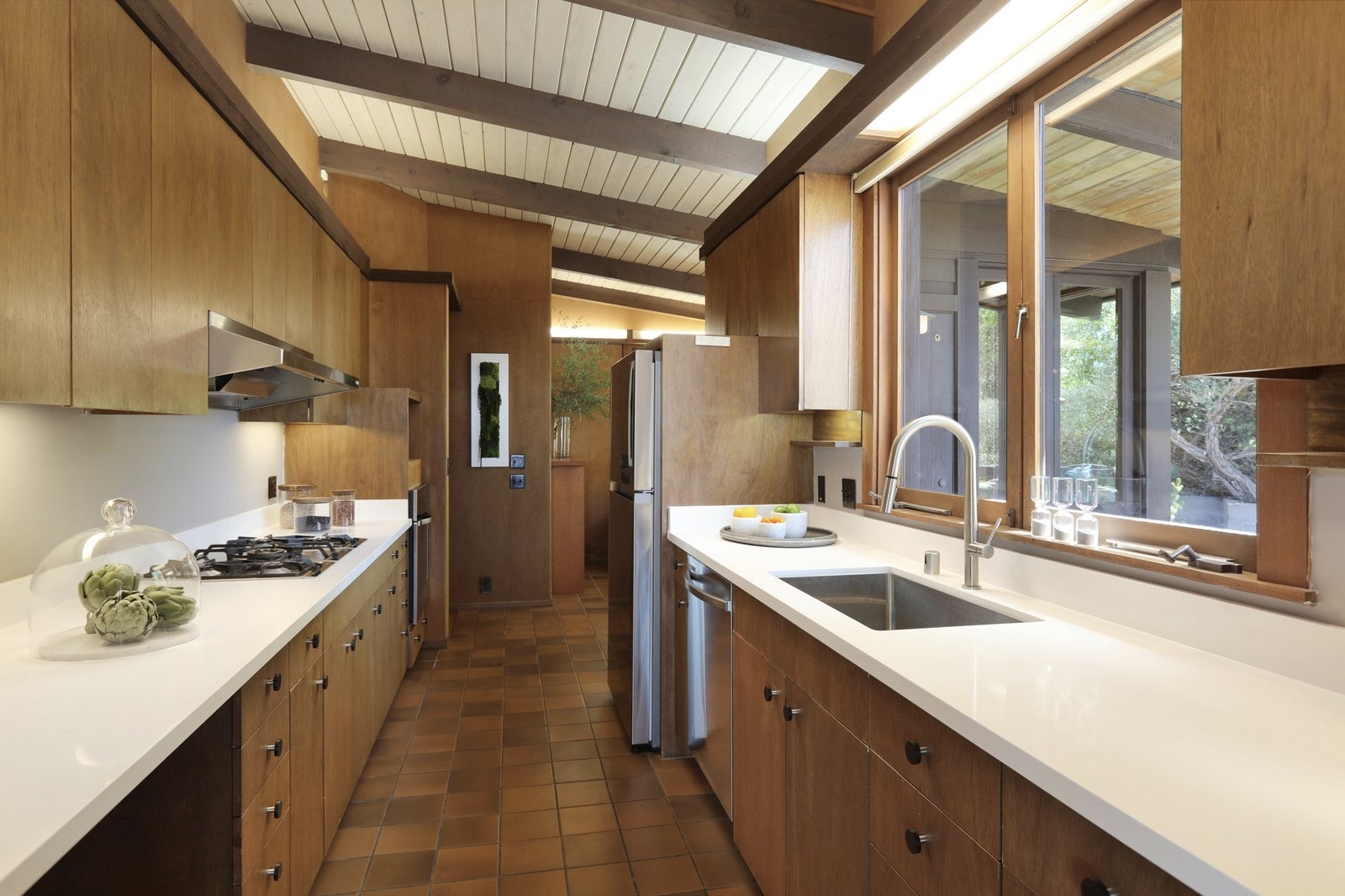 Another view of the kitchen looking back toward a smaller breakfast area in the back.  Photo 8 of 19 in An Alluring Berkeley Hills Home by a Case Study Architect Asks $2.9M