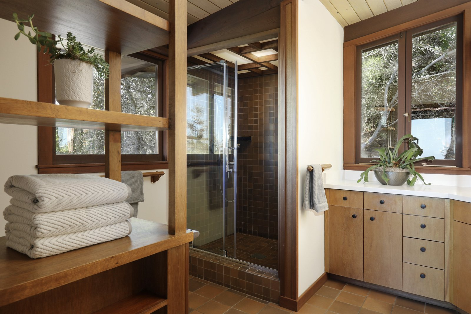 A large shower is located in one corner of the bathroom.  Photo 14 of 19 in An Alluring Berkeley Hills Home by a Case Study Architect Asks $2.9M