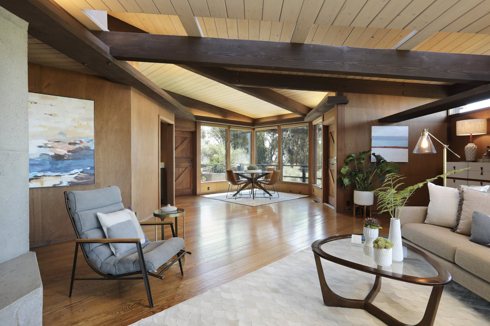 Throughout the interior, wood-paneled walls, hardwood floors,  and tongue-and-groove ceilings complement the post-and-beam design.  Photo 5 of 19 in An Alluring Berkeley Hills Home by a Case Study Architect Asks $2.9M