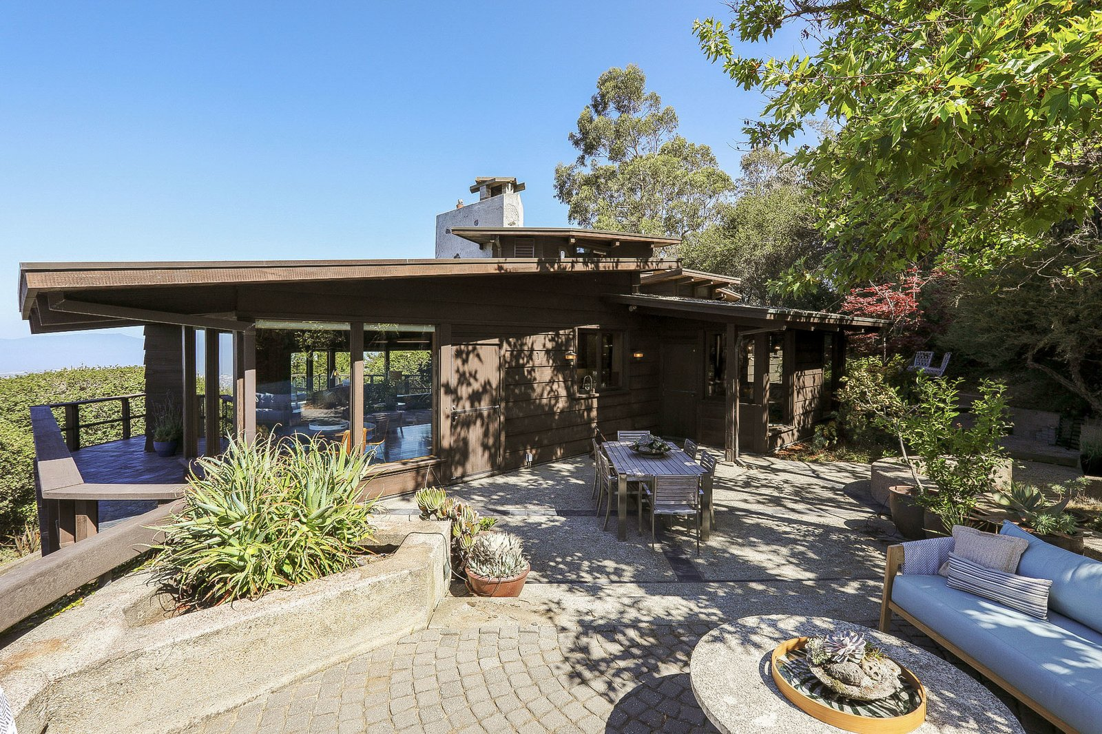 """Originally completed in 1964, this steel-reinforced, post-and-beam design by Beverly """"David"""" Thorne was rebuilt after the devastating Oakland firestorm of 1991, which left only the central concrete chimney standing. The structure is located on private, one-and-a-half-acre lot in the Claremont Hills neighborhood, near the border of Berkeley and Oakland, California.  Photo 2 of 19 in An Alluring Berkeley Hills Home by a Case Study Architect Asks $2.9M"""