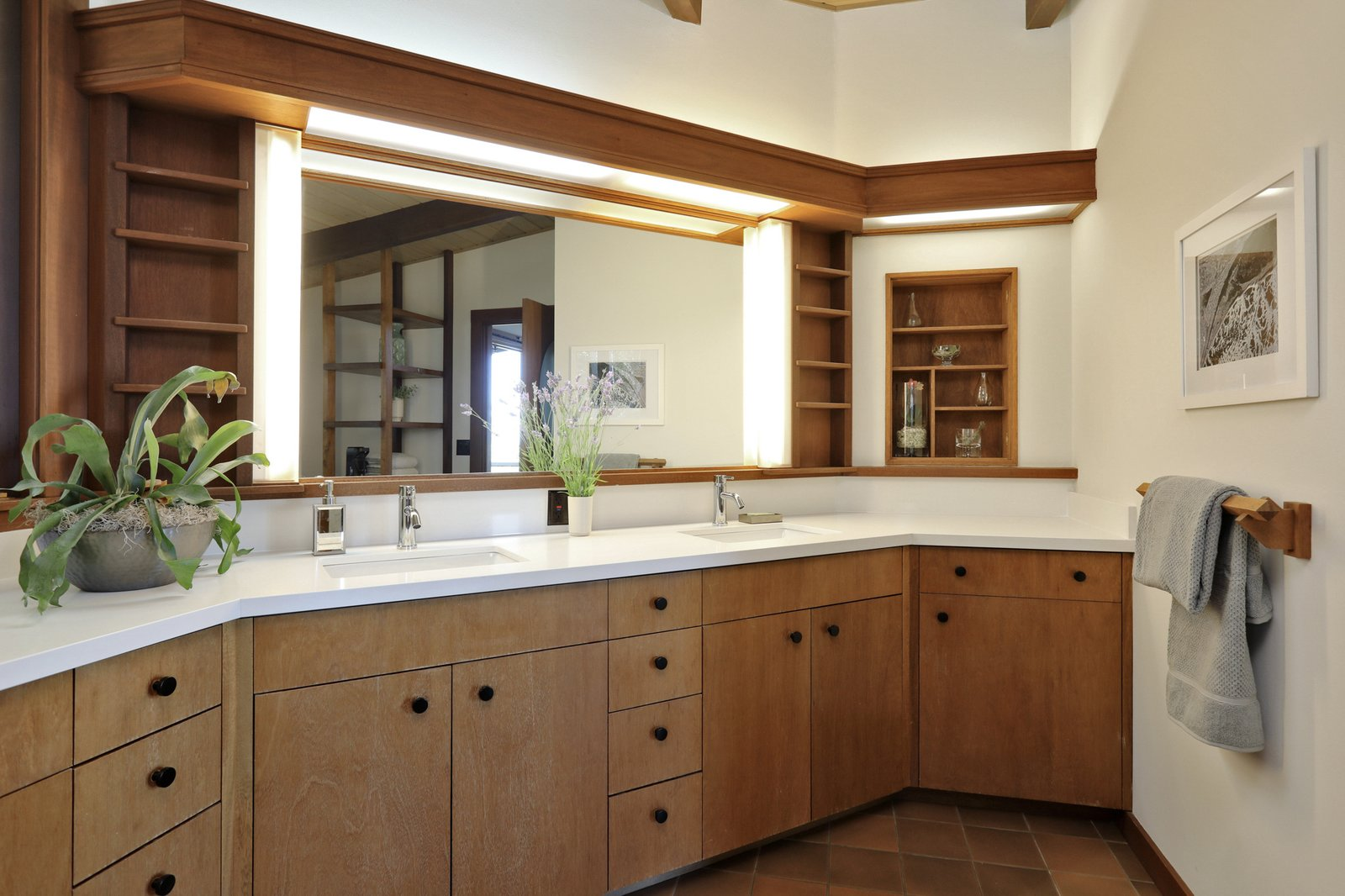 The remodeled master bathroom balances modern fixtures and counters with Thorne's original design for the cabinetry and built-ins.  Photo 13 of 19 in An Alluring Berkeley Hills Home by a Case Study Architect Asks $2.9M