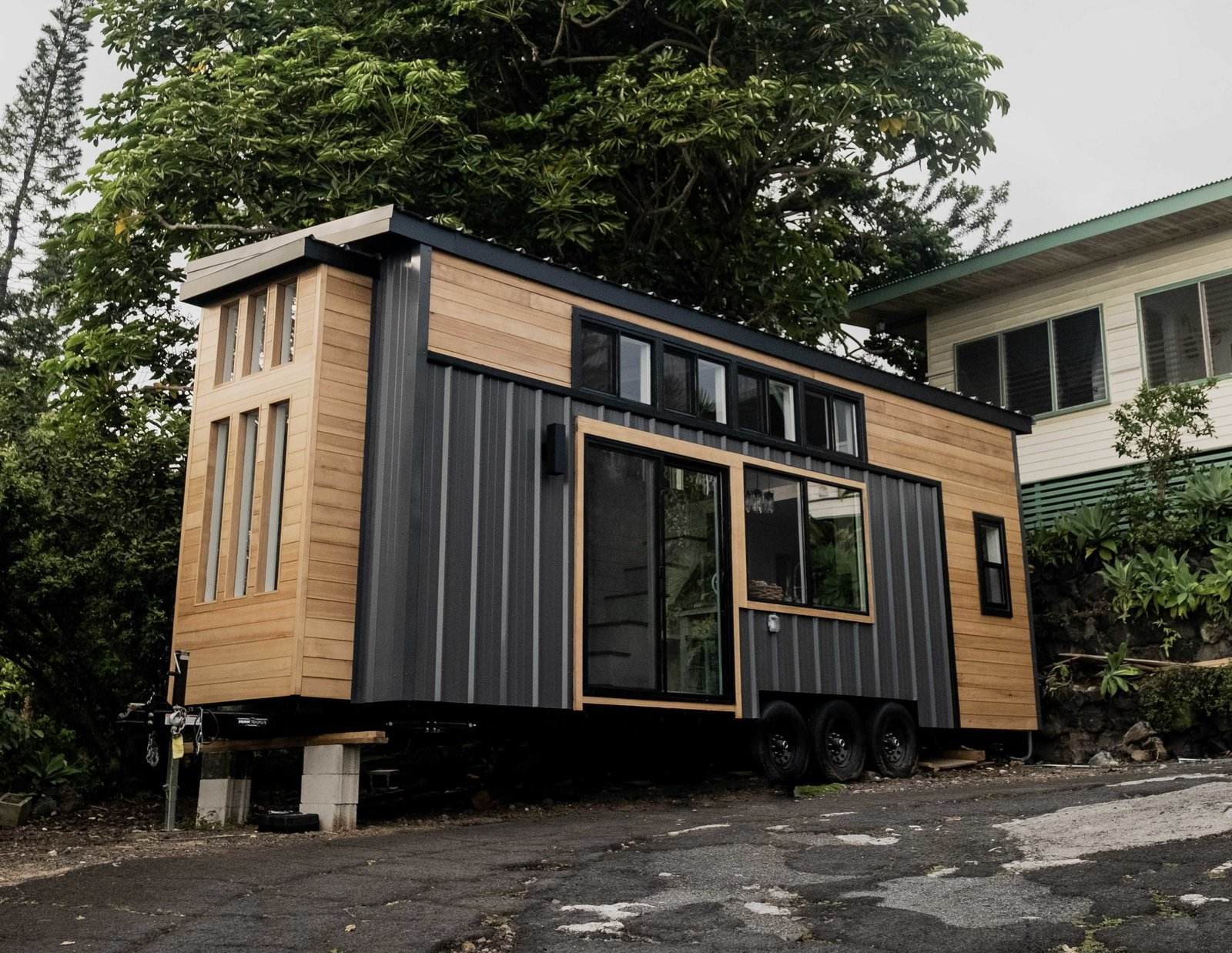 Exterior, Shingles Roof Material, Wood Siding Material, Tiny Home Building Type, and Flat RoofLine Facing a COVID-19 shutdown, Taylor and Michaella McClendon recruit their family to build a breezy tiny home on the Big Island—which you can now purchase for $99,800.  Photo 1 of 14 in A Hawaii-Based Couple Build a Luminous Tiny House in Just 25 Days