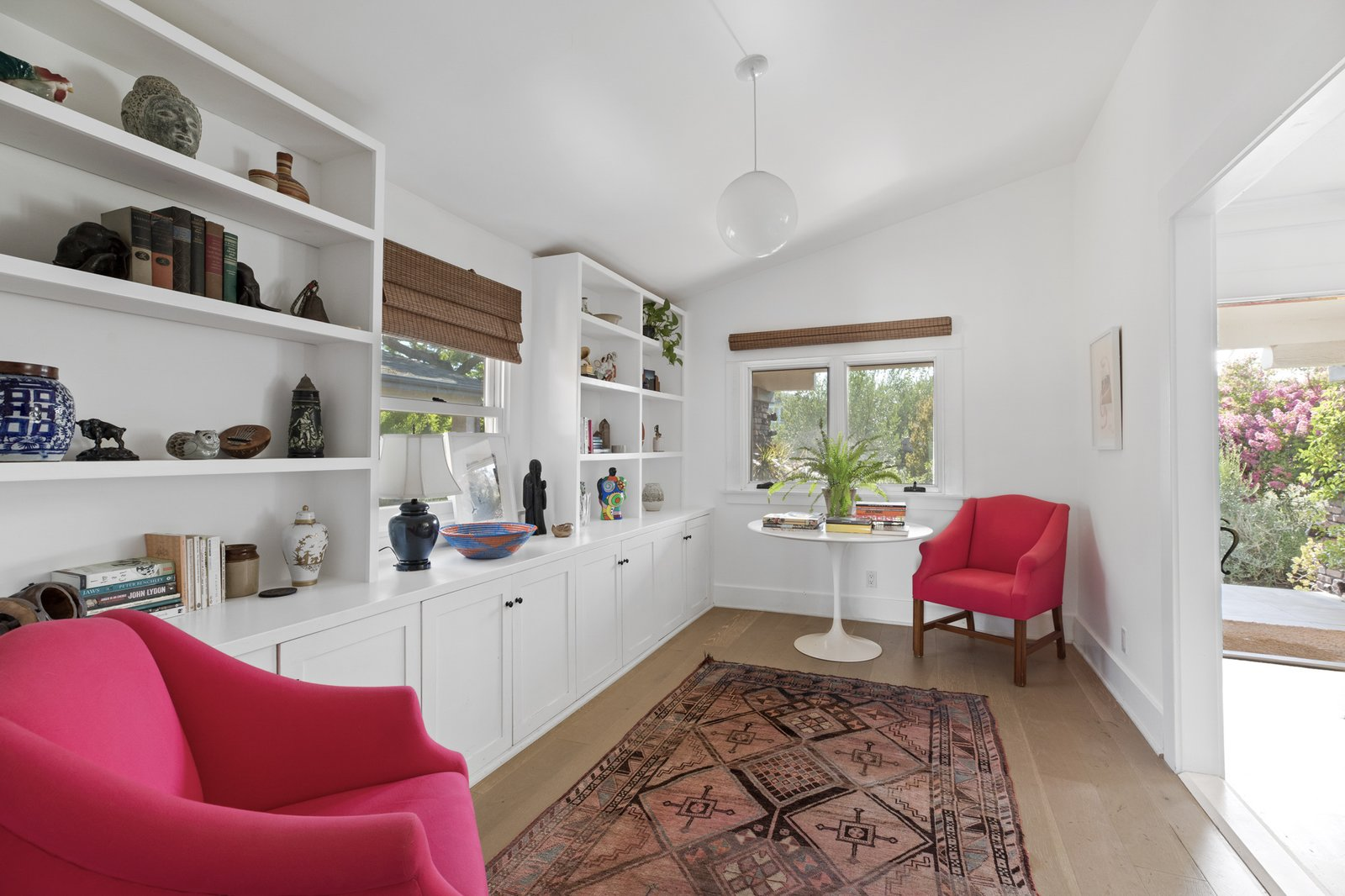Complete with more built-ins, a small reading area is located just off the living area.  Photo 4 of 16 in An Artfully Reimagined California Craftsman Asks $1.2M