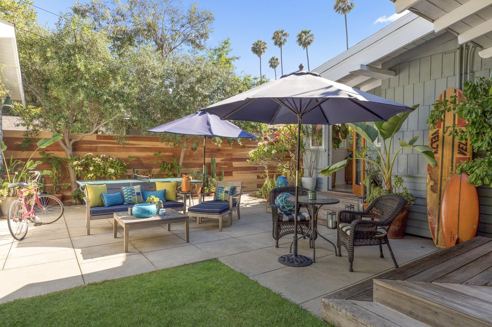 Outside, a concrete patio provides space for entertaining and enjoying the sunshine.   Photo 11 of 16 in An Artfully Reimagined California Craftsman Asks $1.2M