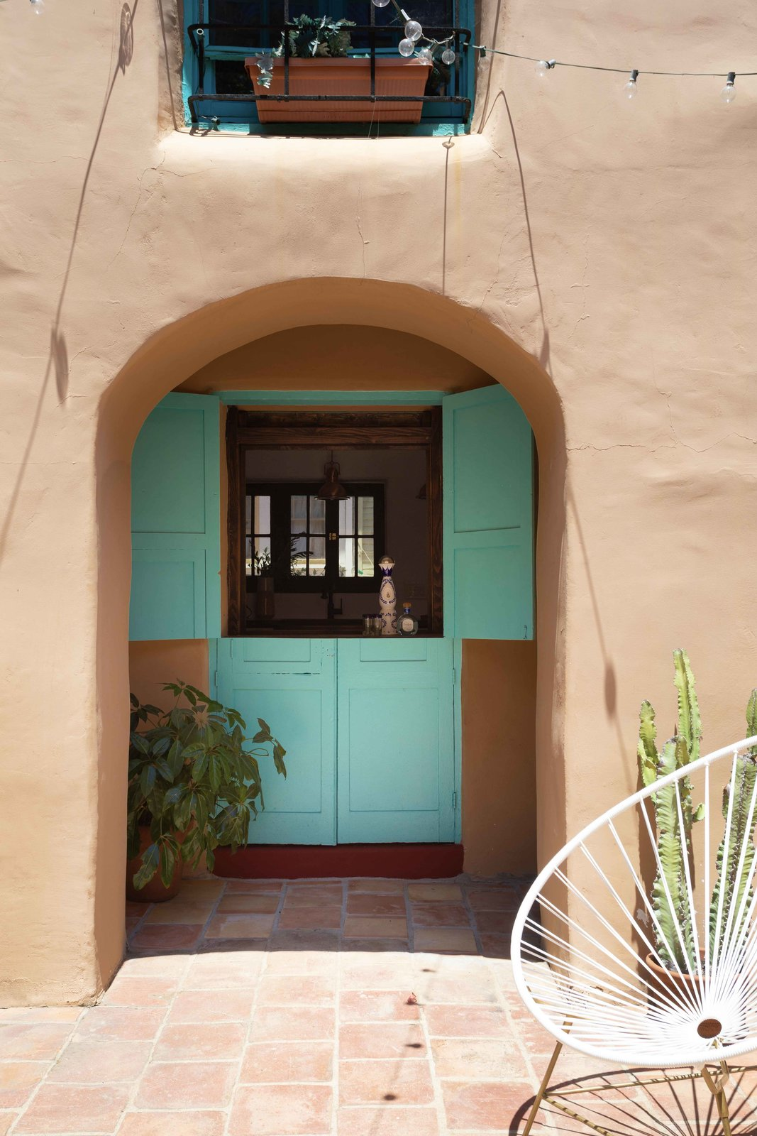 An original doorway is now a window to pass items through from the kitchen counter.  Photo 16 of 20 in The Restored L.A. Home of Poet Alice Lynch Is a Rad Option If Your Budget Stretches to $1.8M
