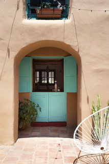 An original doorway is now a window to pass items through from the kitchen.