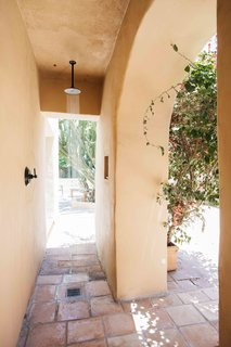 An outdoor shower fills one side of the patio.