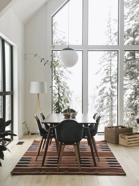A dining area is located in one corner of the living space. The interior light fixtures are from Schoolhouse Electric in Portland, Oregon.