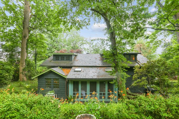 Located within commuting distance to New York City, this early 1900s bungalow is one of two homes designed and built by Gustav Stickley in Maplewood, New Jersey.