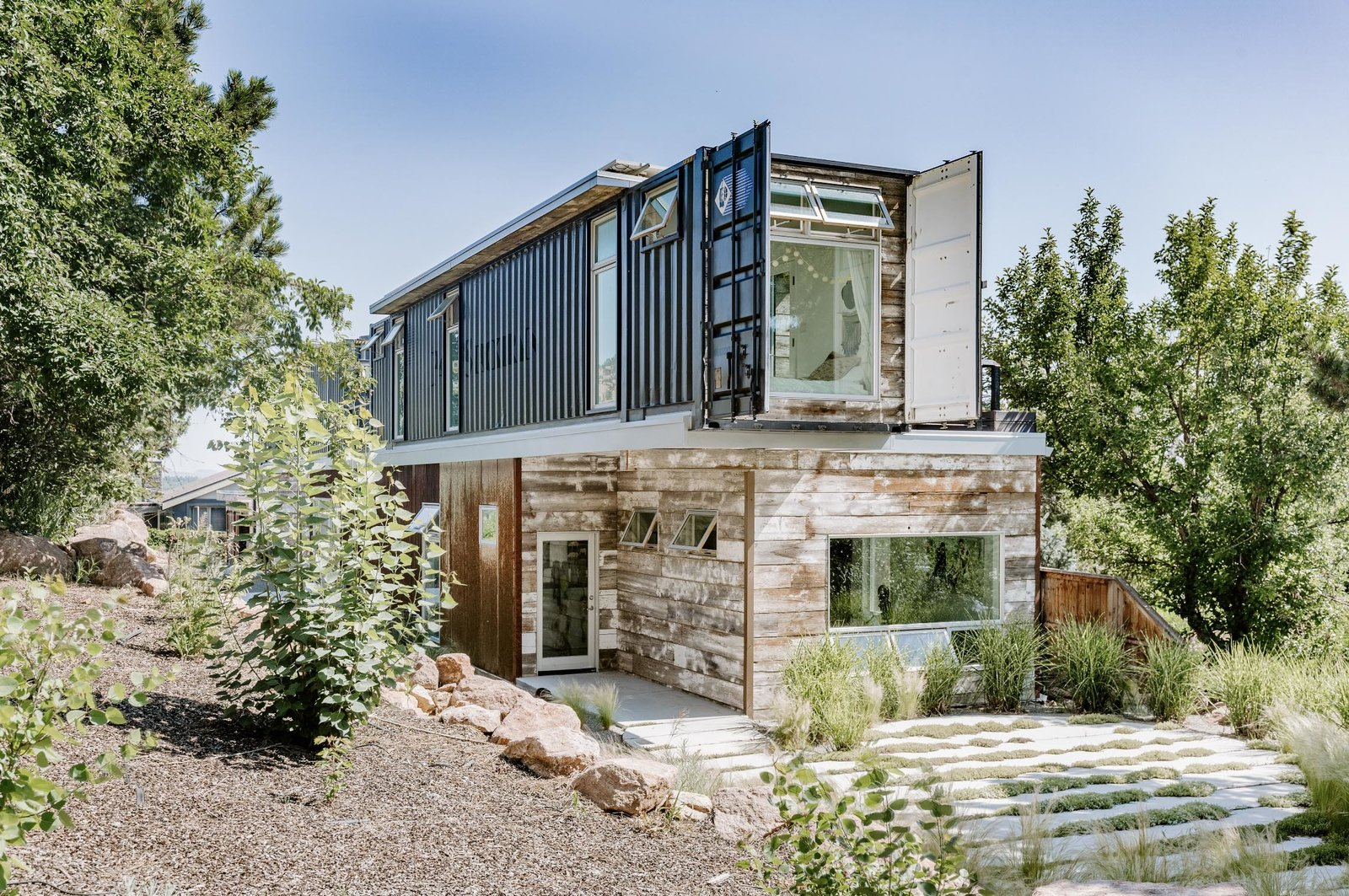 A front view of the home.  Photo 22 of 22 in An Arty Couple Say Goodbye to Their Handcrafted, Net-Zero Shipping Container House for $3.15M