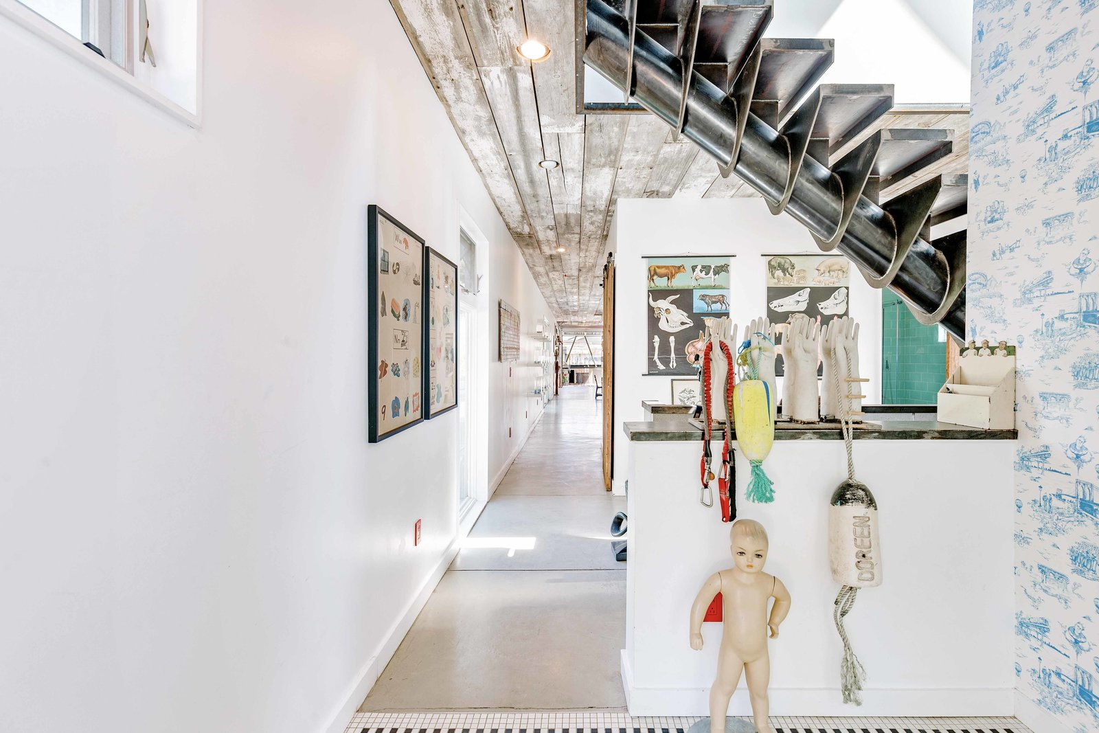 """Inside, the couple designed the home to match their own fun and quirky style. Immediately catching the eye is a metal staircase, the base of which is a <span style=""""font-family: Theinhardt, -apple-system, BlinkMacSystemFont, &quot;Segoe UI&quot;, Roboto, Oxygen-Sans, Ubuntu, Cantarell, &quot;Helvetica Neue&quot;, sans-serif;"""">12  Photo 3 of 22 in An Arty Couple Say Goodbye to Their Handcrafted, Net-Zero Shipping Container House for $3.15M"""
