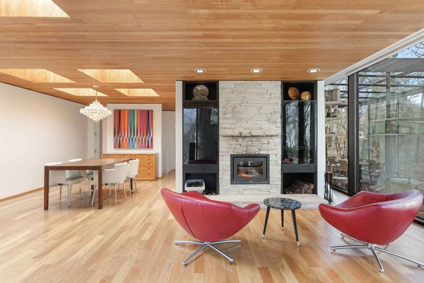 Inside, the home offers original hardwood floors and wood-clad ceilings throughout. The current owners, who purchased the property in 2002, added a living room fireplace and completed some other renovations.