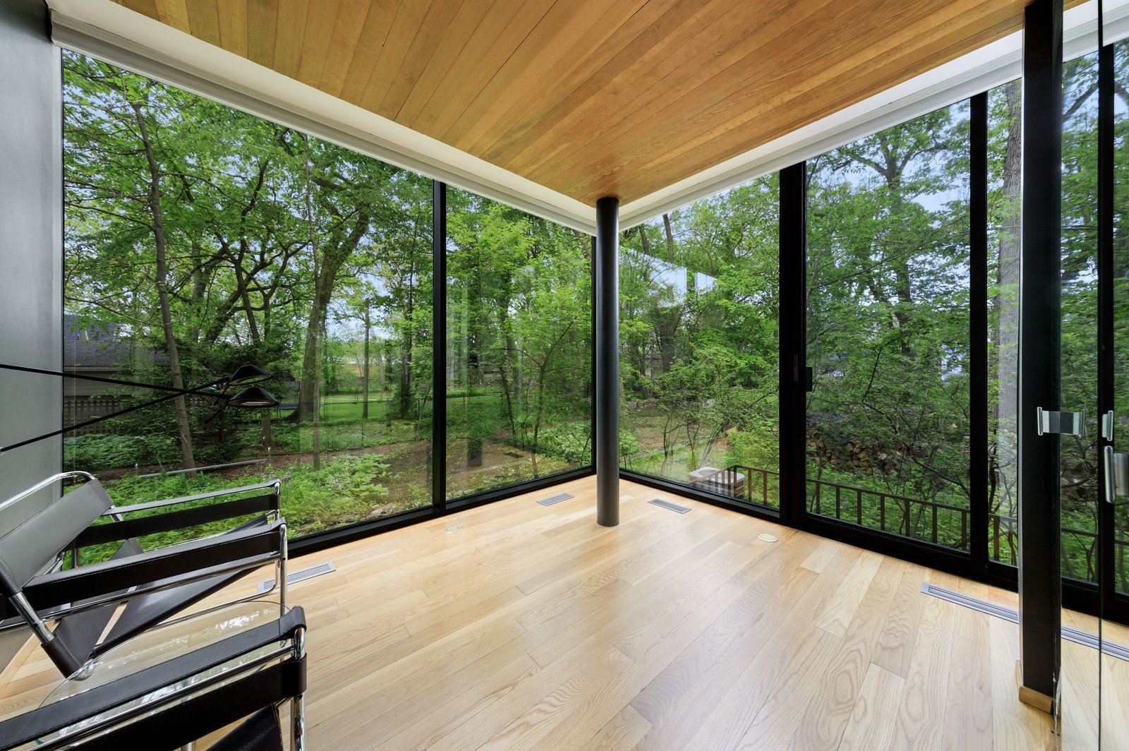 All of the home's four bedrooms are located on the main level.  Photo 11 of 15 in A Blackened Steel and Glass House Outside of Chicago Hits the Market for $825K