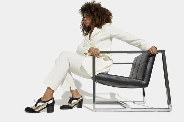 The fall 2020 collection from The Office of Angela Scott honors the ageless beauty and strength of women. Shown here, the Mrs. Doubt Midheel features contrasting shades of leather with intricate brogue details.