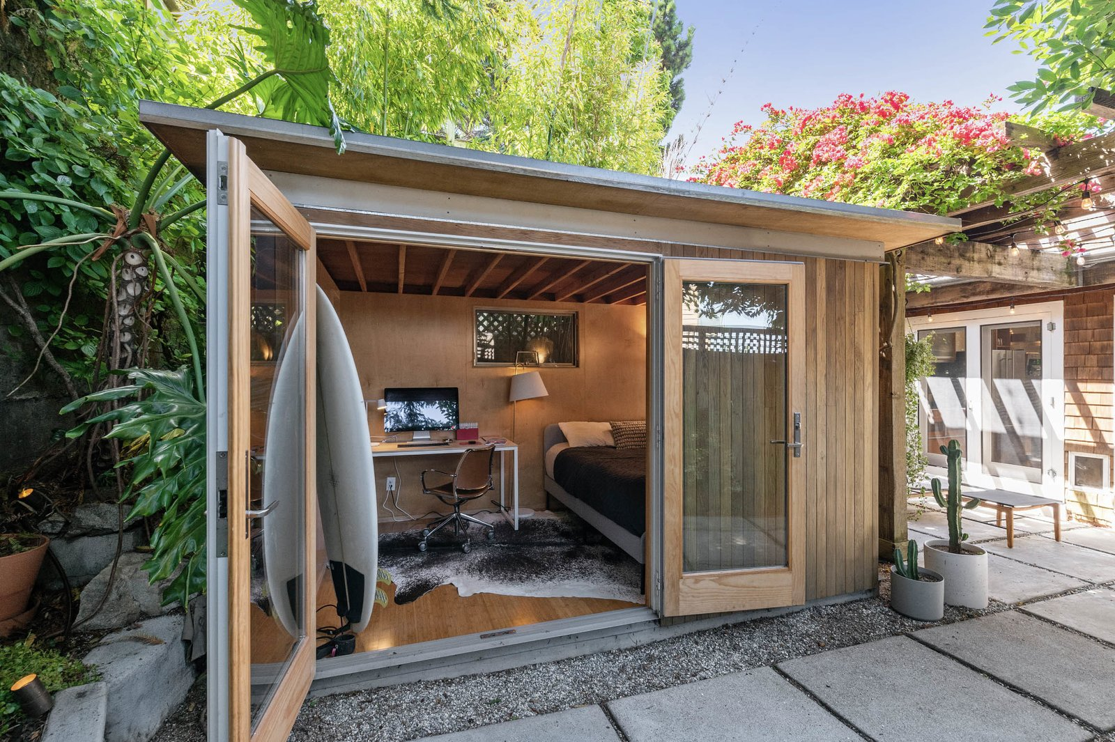 A detached studio is located just behind the home.  Photo 12 of 13 in An Idyllic Cottage With a Garden Studio Seeks $1.8M in San Francisco