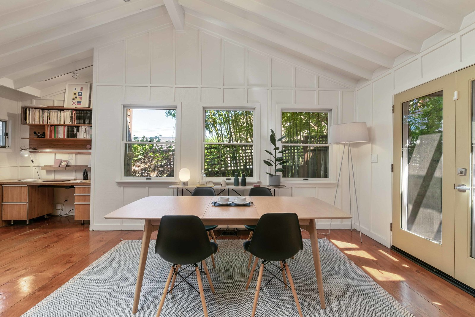 Several windows in the dining area overlook the private garden and patio.  Photo 6 of 13 in An Idyllic Cottage With a Garden Studio Seeks $1.8M in San Francisco