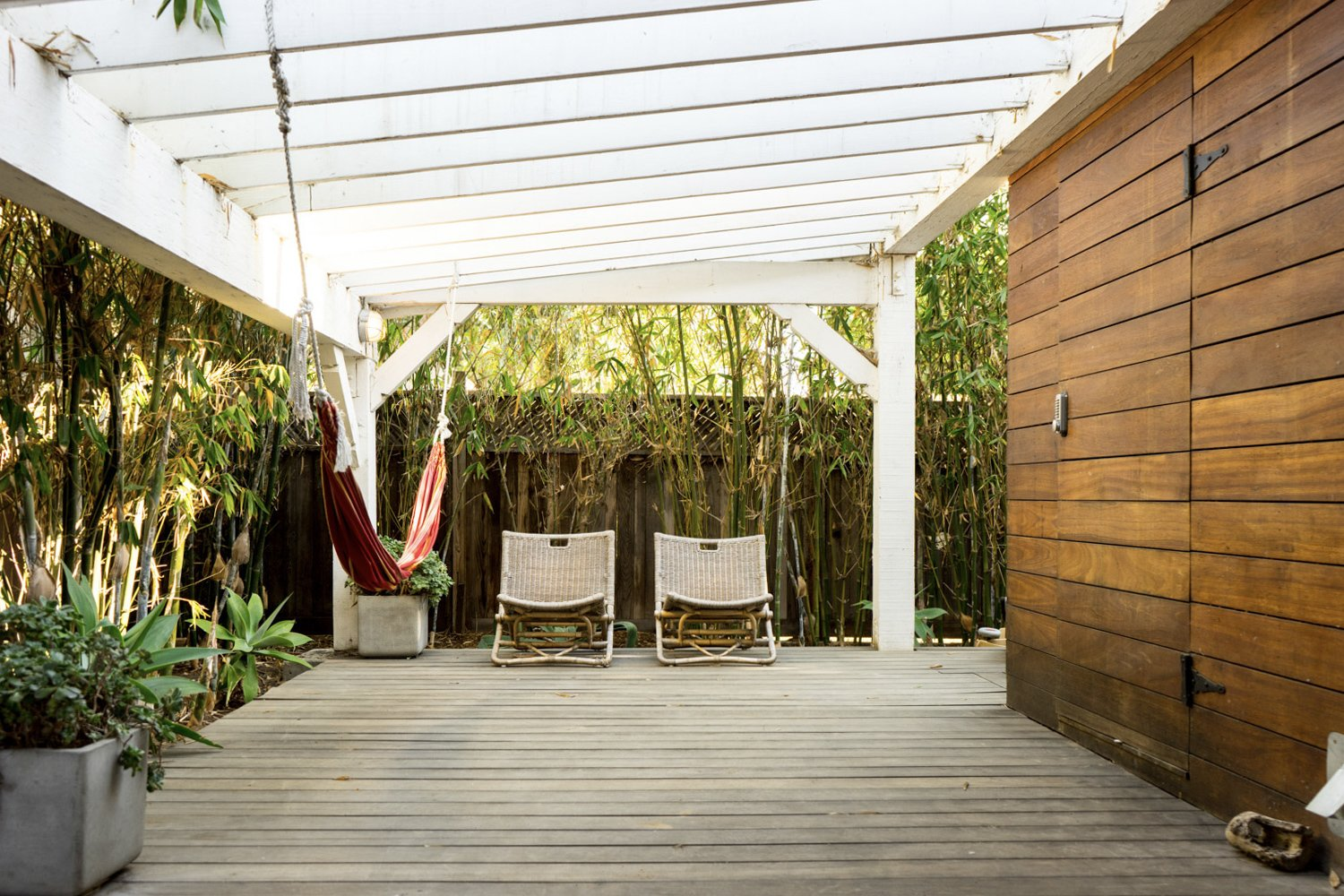 "A shady outdoor space is located along another side of the studio.  Photo 9 of 17 in The ""Surf Shacks"" Author Lists His Venice Bungalow and Backyard Guesthouse for $1.6M"