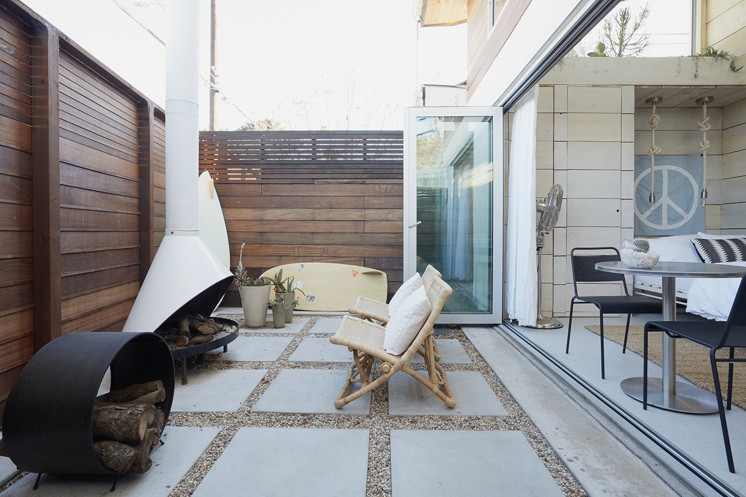 "At the back of the studio, another set of bi-folding doors open onto an enclosed patio.  Photo 8 of 17 in The ""Surf Shacks"" Author Lists His Venice Bungalow and Backyard Guesthouse for $1.6M"
