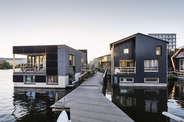 """""""For most of us, this is the first home we've owned and the first house we built ourselves. These are all floating homes, with specific requirements for materials. It wasn't easy,"""" explains resident Wouter Valkenier."""