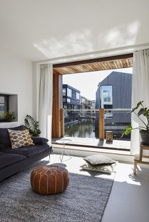 Another view of Manon van der Zwaal's home shows the living area overlooking the canal.
