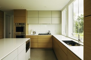 Two large windows illuminate the kitchen with natural light.