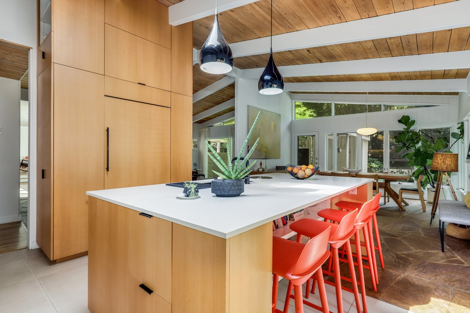 The space also features a large central island that's topped with quartz counters and illuminated by an overhead skylight.