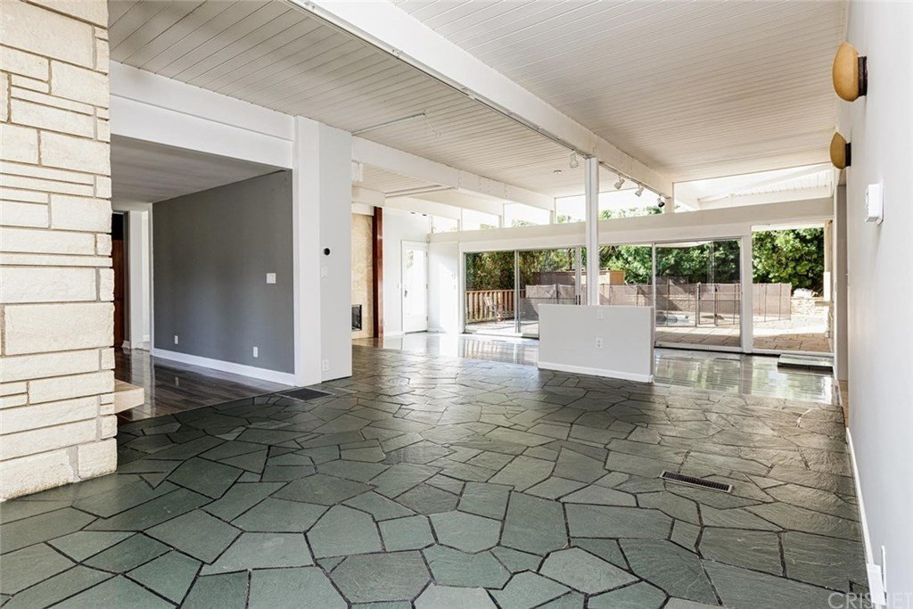 A central post and half wall previously divided the living and dining area.  Photo 6 of 25 in Before & After: Two Brothers List Their Swanky Midcentury Bachelor Pad for $1.6M