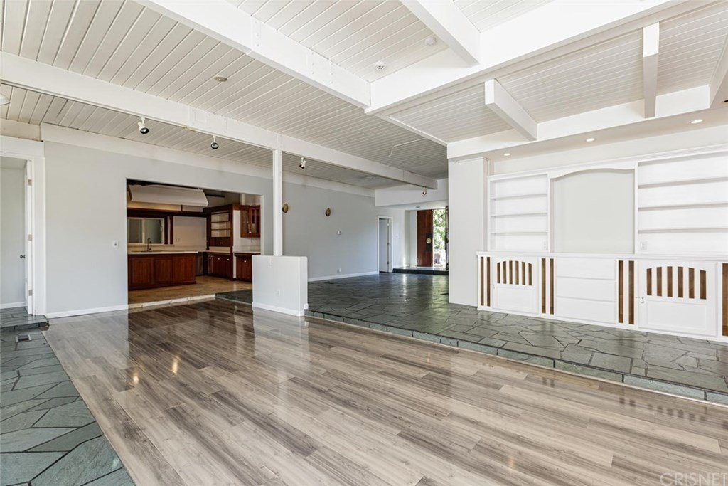 The previous living area was also divided by a raised floor around the perimeter. The kitchen was tucked into an alcove along the side.  Photo 10 of 25 in Before & After: Two Brothers List Their Swanky Midcentury Bachelor Pad for $1.6M