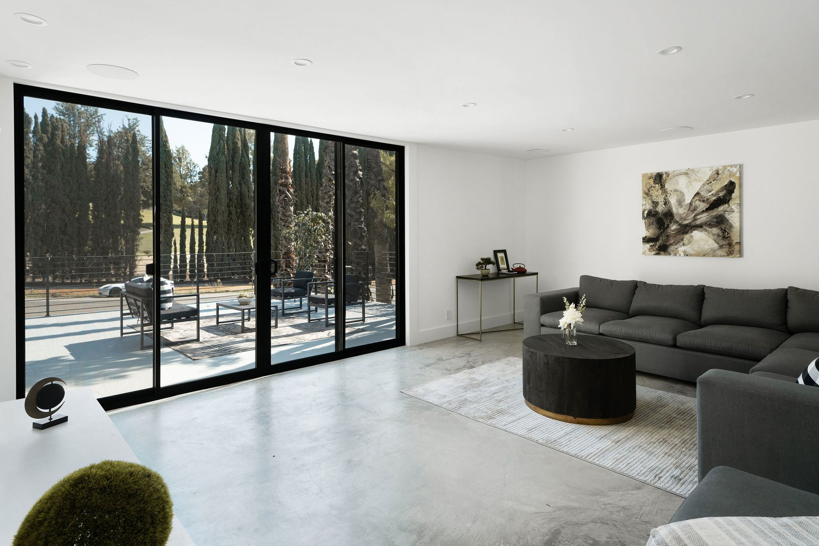 New sliding glass doors provide direct access to the front deck.  Photo 19 of 25 in Before & After: Two Brothers List Their Swanky Midcentury Bachelor Pad for $1.6M